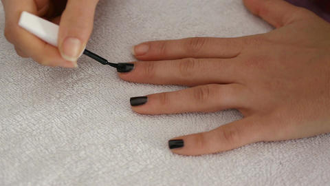 Woman paints her finger nails Footage