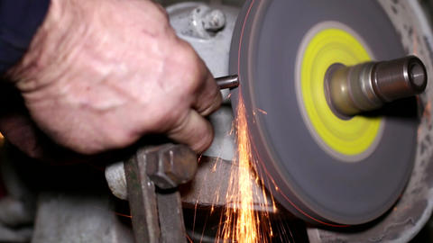 Filing A Piece Of Iron With A Rotating Filing Mach stock footage