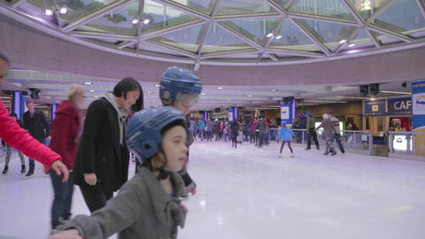 Ice rink at Robson Square - people skating Live Action