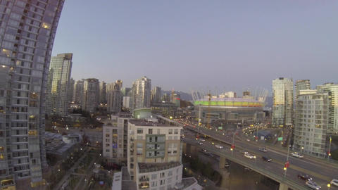 takeoff aerial towards BC place downtown on cambie Live Action