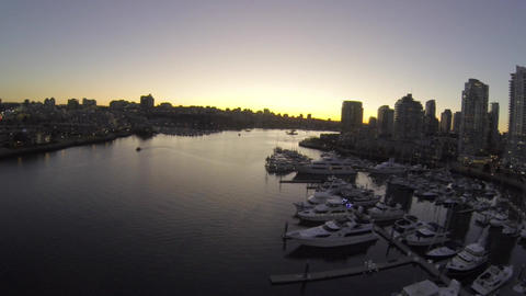 aerial - evening floating over marina at Yaletown  Footage