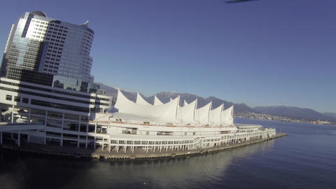 aerial - pan towards Canada place and mountains Live Action