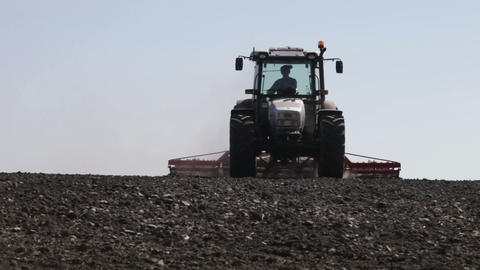 tractor plowing as much dust and leaves worth Footage