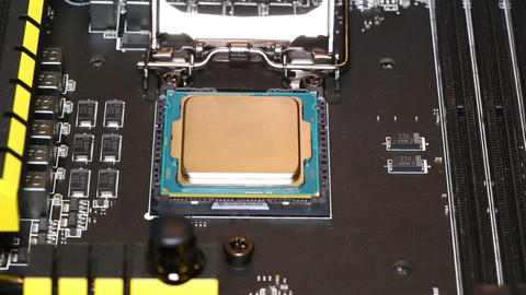 Installing central processor unit into motherboard Footage