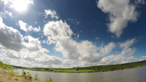 timelapse with clouds moving over river 4k Footage
