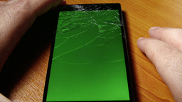 4K Broken Screen Smartphone With Green Background  stock footage