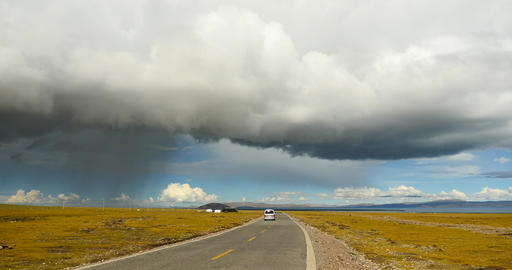 4k huge clouds mass rolling over namtso road,cars traveling on the road Footage