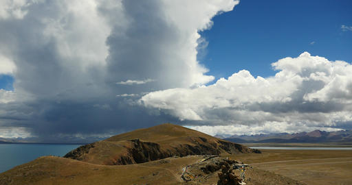 4k huge clouds mass rolling over lake namtso & mountain,Buddhism mani Stone Live Action