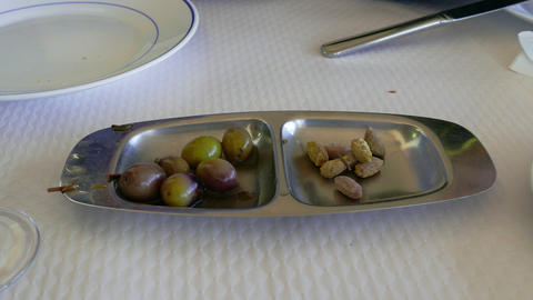 Women and Men Hands Taking Olives from Bowl Footage