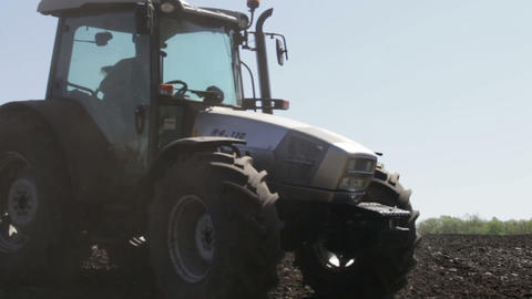 tractor plowing as much dust and unfold Footage