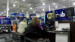People buying new smart phone inside Best buy stor Footage