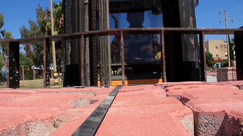 Forklift truck loader going with pavement dalles Live Action