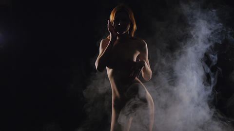 Young Girl Posing (nude, Naked) In Smoke stock footage