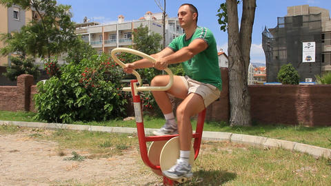 Sportsman On A Exercise Bicycle stock footage