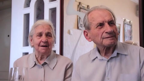 Couple of elderly people seeing a film about past times Footage