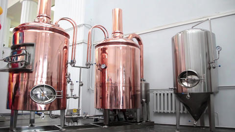 Copper tuns for brewing at a brewery Footage