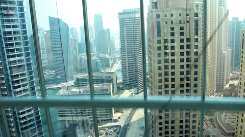 View from glass elevator looking out on Dubai, United Arab Emirates Footage