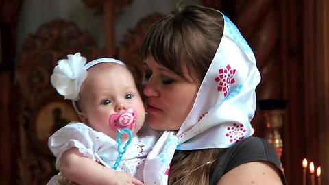 Mother with baby in orthodox church Footage