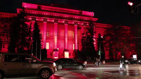 Road traffic near red building of Kiev National University in Ukraine Footage