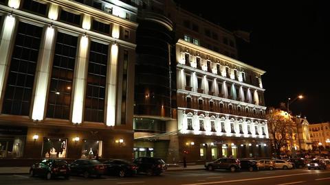 Cars near building with night illumination Footage