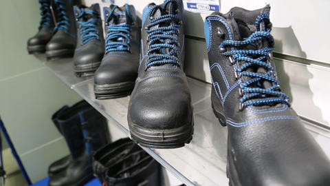 Black Men High Shoes With Blue Laces On The Shelf  stock footage