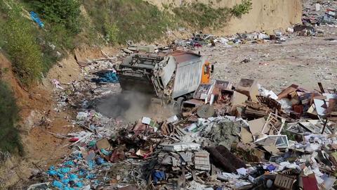 Garbage truck unloads waste Footage