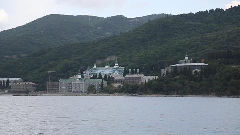 Ship sails along peninsula of Athos, autonomous monastic state, Greece Footage