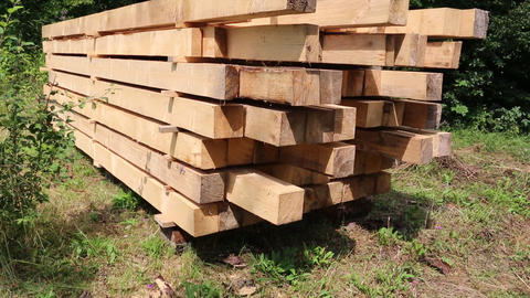 Wooden squared timbers for the building of wooden house Live Action