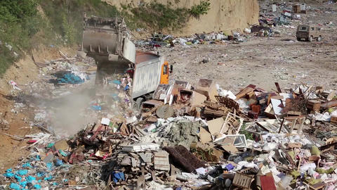 Garbage truck on landfill Footage
