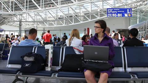 Girl in airport with notebook Live Action