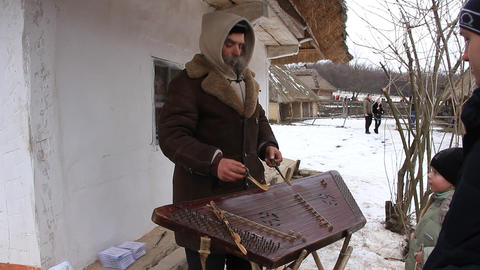Elderly village musician Live Action