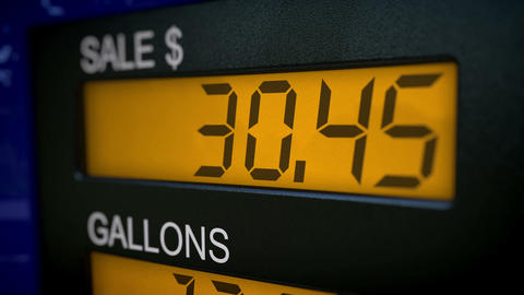 Closeup with slow zoom in on gas pump display Animation