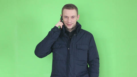 young man talking at phone close up winter time Footage