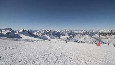 Alpine skier skiing short swings on ski slope Footage
