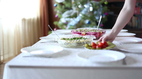 Young woman serves a festive table Footage