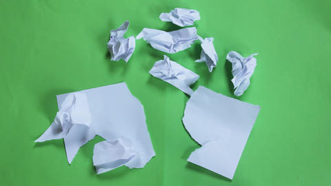 Stop Motion Paper Opening Green Screen stock footage