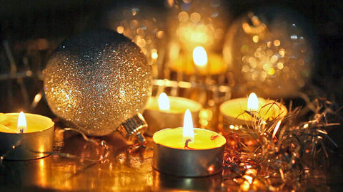 Burning small candles and Christmas tree decoratio Footage