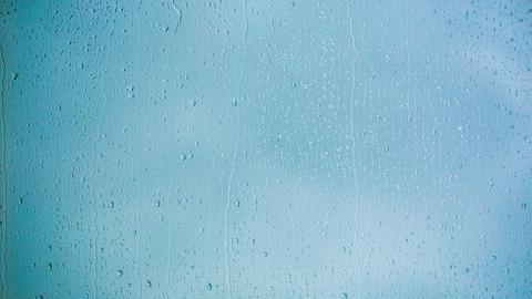 Beautiful Rain Drops running down a Window pane. H Footage