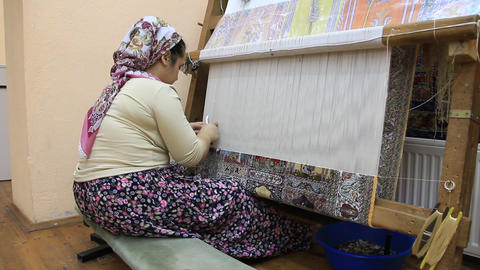 Carpet Weaving. Turk Woman Making A Silk Carpet stock footage