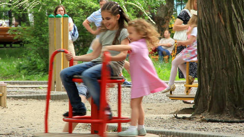Little girls on the merry-go-round Footage