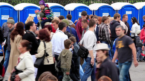 Crowd of people near outdoor public toilets Footage