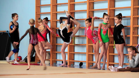 Girls gymnasts having training in gym before examination in Deriugina school Footage