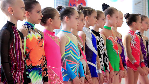 Young girls gymnasts in gym after final examination in Deriugina school Footage