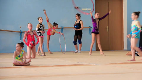 Girls gymnasts having training in gym before examination in school of gymnastics Footage