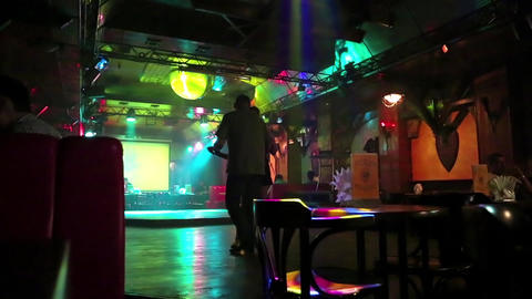 Young couple dancing in a restaurant Live Action
