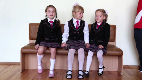 Three Girls Sitting On A Bench In The School stock footage