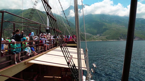 People traveling by ship near Mount Athos Live Action