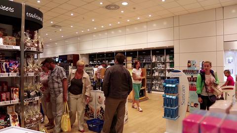 People inside duty free store Footage