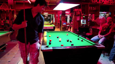 Men playing billiards inside big billiards club Footage