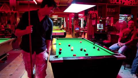 Men playing billiards inside big billiards club Footage